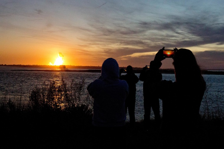 Image: Spectators in Chincoteague, Va. watch the fireball from the explosion