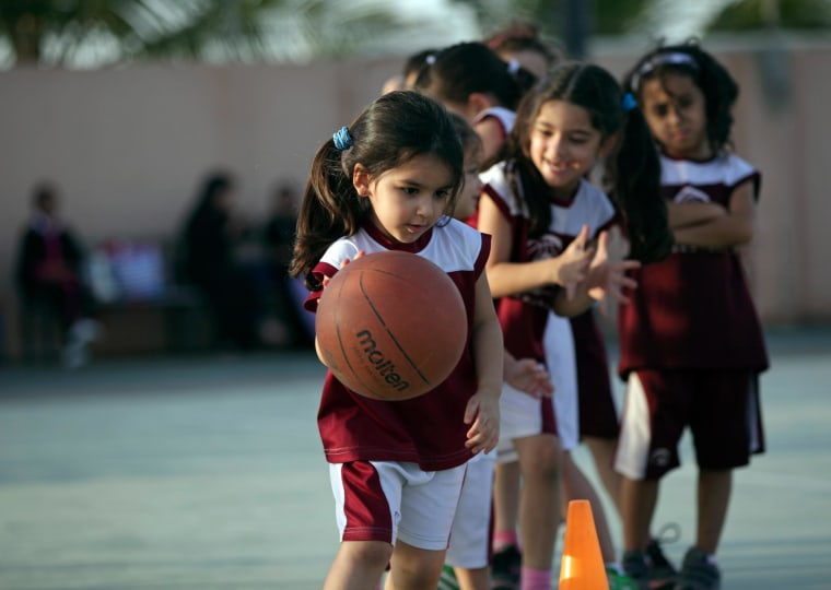 Image: Saudi and expatriate girls practice basketball at a private sports club