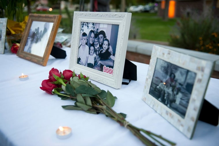 Image: Photos of the Strack family are displayed during a vigil for the family at Pioneer Park in Provo, Utah, on Oct. 2.
