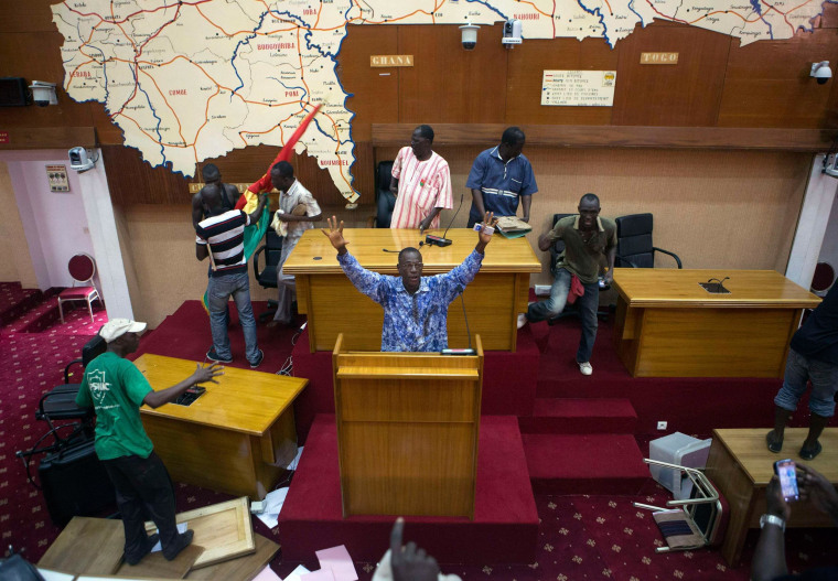 Image: Anti-government protesters take over the parliament building in Ouagadougou