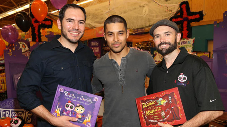 "Co-Creator and Animation Director of Muertoons, Eric Gonzalez, Wilmer Valderrama, and Co-Creator of Muertoons, Erich Haeger, pose during the new animated series launch of ""Muertoons"" on Friday, Oct. 24, 2014 at the Northgate Gonzalez Market in Los Angeles, Calif."