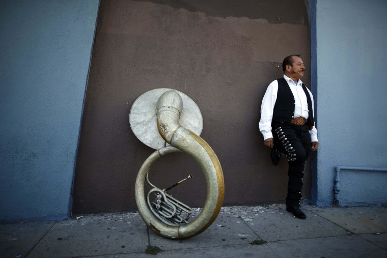 Image: Mariachi musician Moises Rivera waits for a gig in the Boyle Heights area of Los Angeles