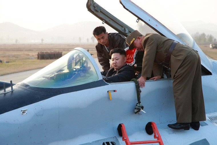 Image: North Korean leader Kim Jong Un sits in an airplane as he guides a flight drill for the inspection of airmen of the Korean People's Army Air and Anti-Air Force