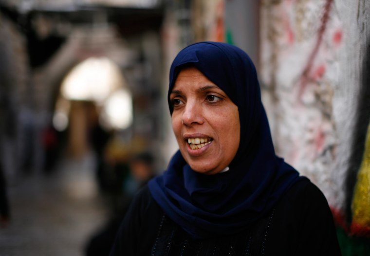 Nahil Salayme, 42, a resident of East Jerusalem, heads home after praying at the Al Aqsa mosque in Jerusalem. She was refused access yesterday after Israeli security forces closed the site yesterday following an attack on a prominent right wing Jewish act