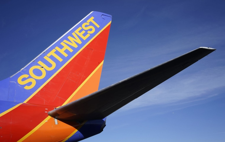 Image: A Southwest Airlines jet waits on the tarmac at Denver International Airport in Denver.