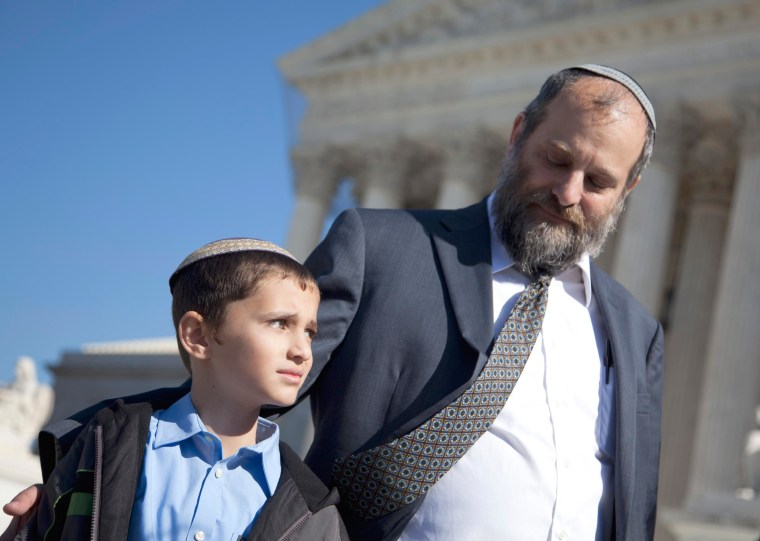 Image: Ari Zivotofsky, right, stands with his son, Menachem, outside the Supreme Court