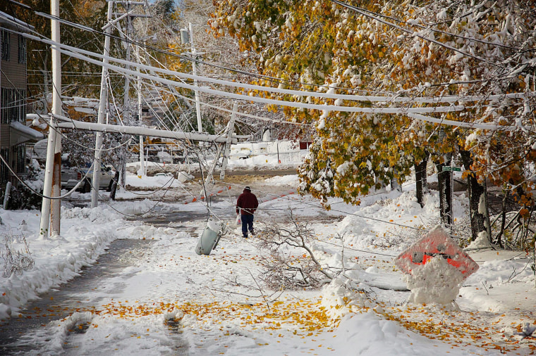 Image: Downed lines on Sanford Street left the road closed and area residents unable to leave their homes after a storm brought several inches of wet snow in Bangor