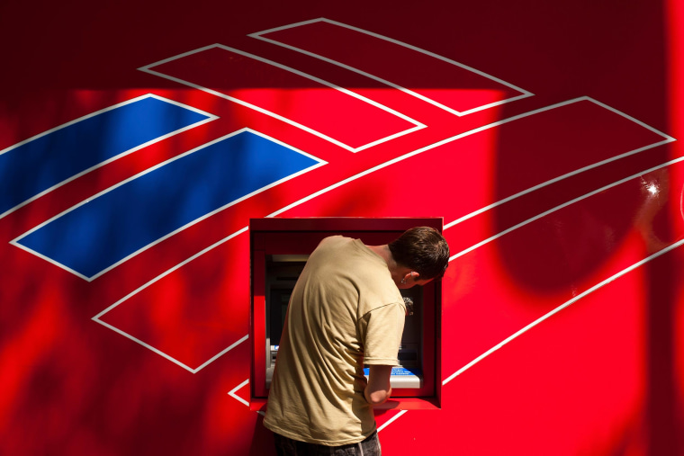 Image: A Bank of America customer uses a Bank of America ATM in Charlotte
