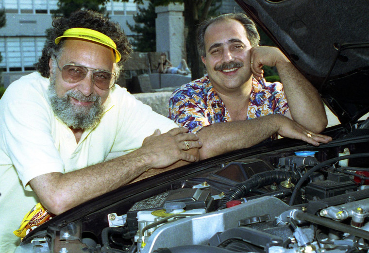 Image: Brothers Tom, left, and Ray Magliozzi pose under a car hood in Boston on July 9, 1991.