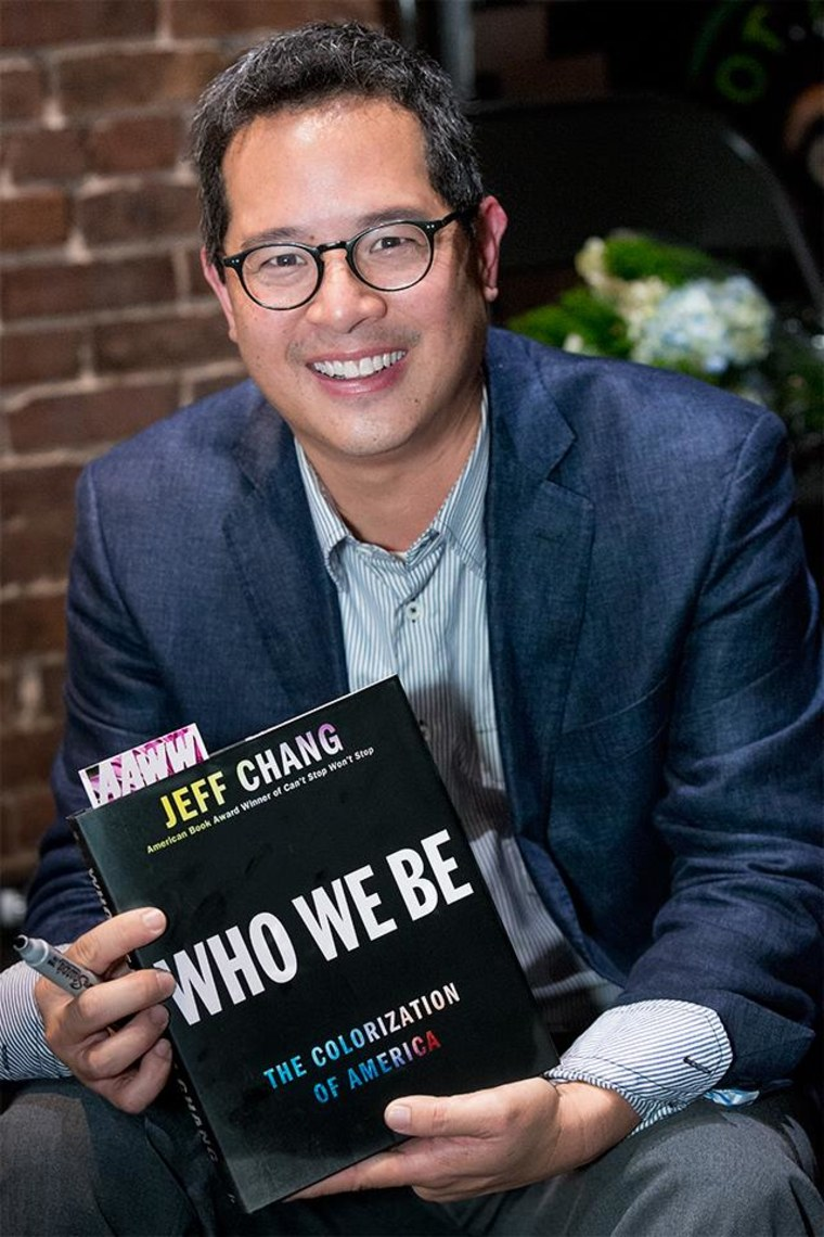 """Jeff Chang holds a copy of his new book, """"Who We Be: The Colorization of America."""""""