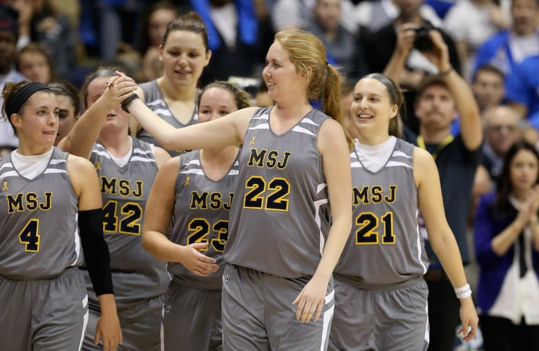 Lauren Hill of Mount St. Joseph celebrates with her teammates after the game against Hiram at Cintas Center on Nov. 2, in Cincinnati, Ohio. Hill, a freshman, has terminal cancer and this game was granted a special waiver by the NCAA to start the season early so she could play in a game.