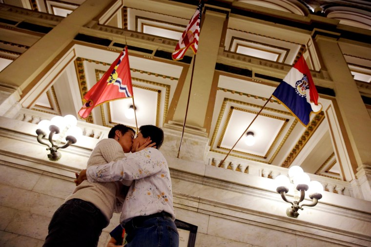 April Dawn Breeden, left, and her long-time partner Crystal Peairs kiss after they were married Wednesday, Nov. 5, 2014, at City Hall in St. Louis. St. Louis Circuit Judge Rex Burlison overturned Missouri's ban on gay marriage on Wednesday saying the law is unconstitutional.