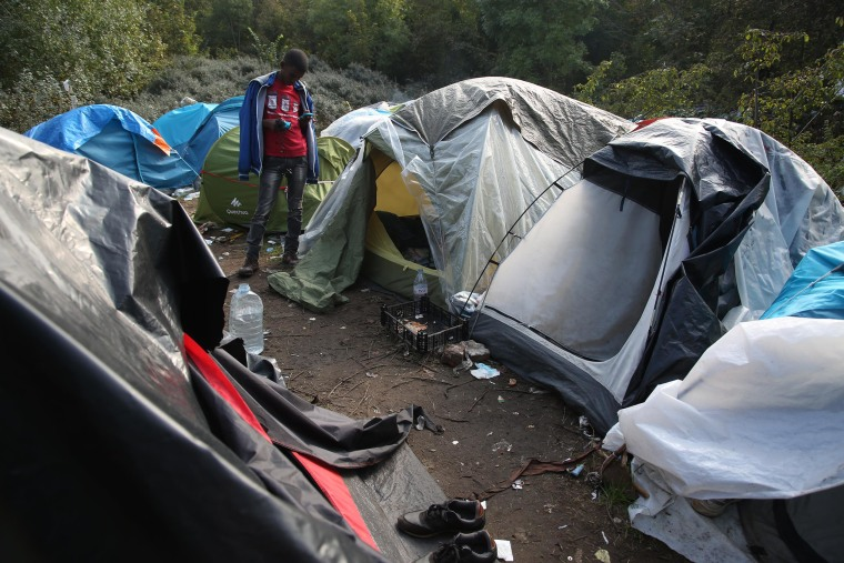 Image: Migrants living in tents in Calais, France