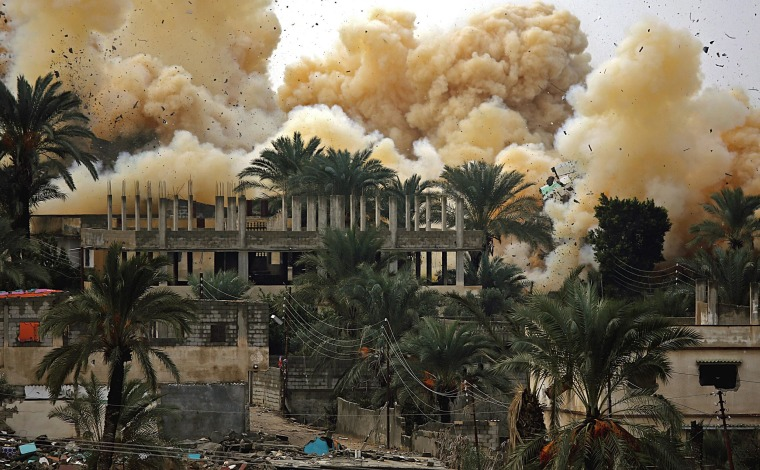 Image: Smoke rises as Egyptian forces demolish homes as part of a military operation