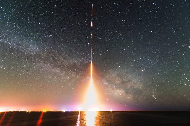 This is a time-lapse photograph of the Cosmic Infrared Background Experiment rocket launch, taken from NASA's Wallops Flight Facility in Virginia in 2013. The image is from the last of four launches.