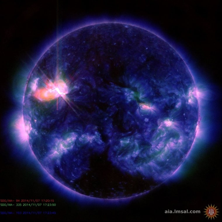 This extreme ultraviolet image from NASA's Solar Dynamics Observatory shows the flash of a solar flare emanating from Active Region 2205 on Friday. Solar scientists said the flare peaked at 12:26 p.m. ET.