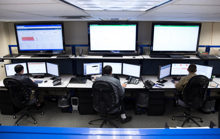 Image: Exelis analysts work to identify threats against their company in the Cyber Incident Response Center.