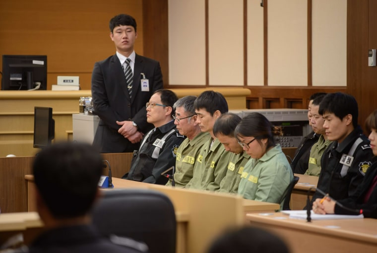 Image: Lee Jun-Seok, third on right, sits with other crew members inside a courtroom on Tuesday