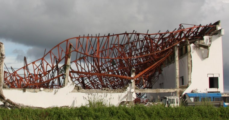 Twisted, steel remains of what were once roofs dot the landscape in Leyte, one year after Typhoon Haiyan.