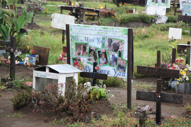 Mass grave in a churchyard outside of Tacloban, on Leyte, one year after Typhoon Haiyan.