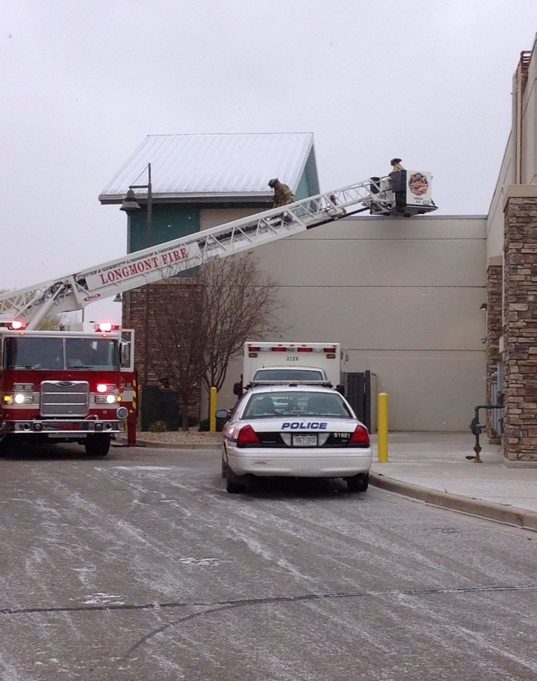 Image: Firefighters rescued a man from the wall of a Marshalls store in Longmont, Colo.