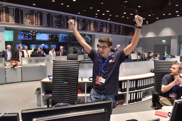 Image: Handout photo of technician celebrating successful landing of Philae lander on comet 67P/ Churyumov-Gerasimenko at the ESA headquarters in Darmstadt