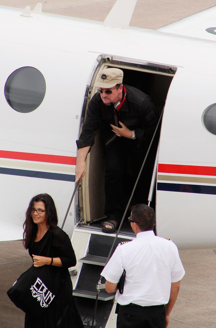 U2 singer Bono gets out of an airplane after arriving in Cuzco, Peru, February 24, 2012.