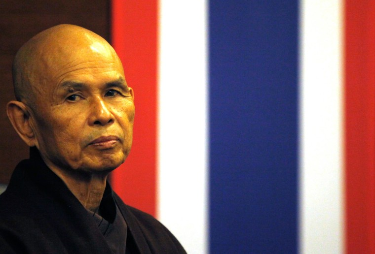 Image: French-based Buddhist zen master Thich Nhat Hanh gestures during his arrival at Suvarnabhumi airport in Bangkok