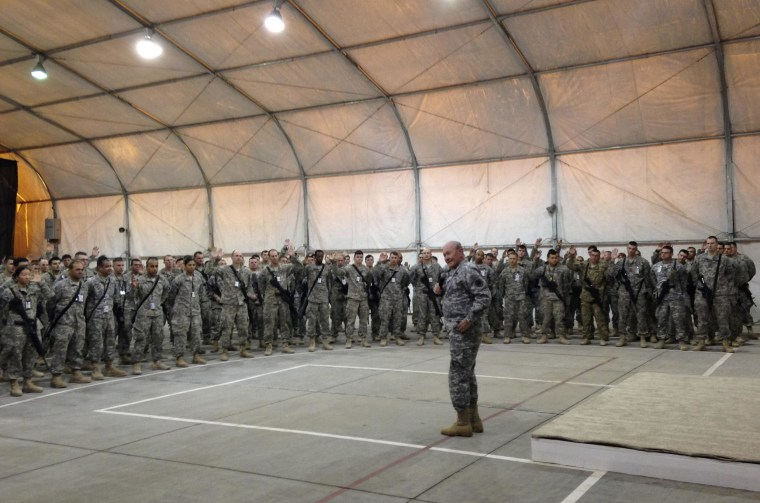 Image: U.S. Army General Martin Dempsey, chairman of the Joint Chiefs of Staff, speaks with soldiers in Iraq