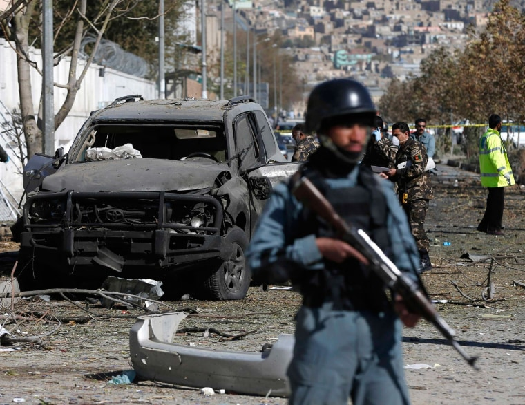 Image: Afghan security forces inspect the site of a suicide attack in Kabul, on Sunday