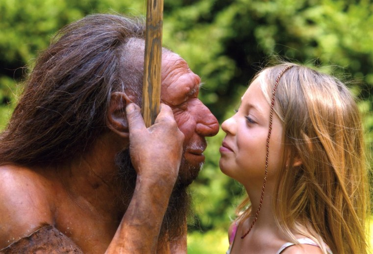 Image: Girl and Neanderthal statue