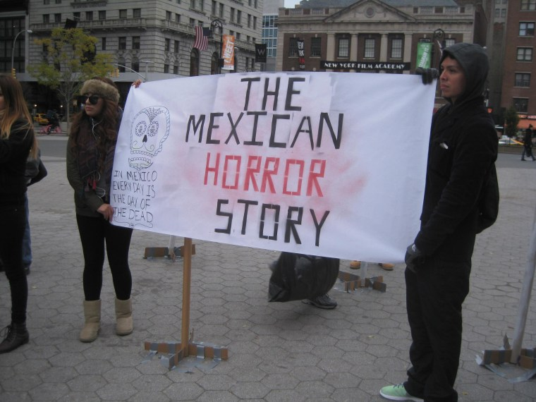 Fathers, mothers, children, activists and others gathered for a vigil in New York City on Sunday, Nov. 16 to demand justice for the 43 students from Guerrero, Mexico who disappeared over 7 weeks ago.
