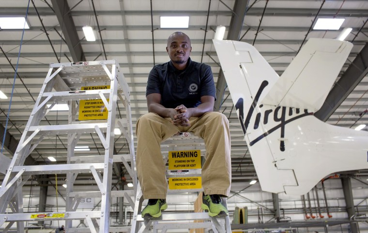 """Robert Kaai, 34, is """"SpaceWrench"""" for Virgin Galactic — which means he helps maintain the vehicles before and after flight. He was previously a mechanic at Frontier Airlines."""