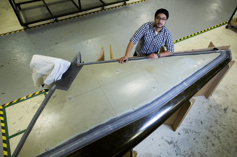 Zia Qadir is structural design engineer at The Spaceship Company, and is involved in testing components for SpaceShipTwo Serial No. 2. He's working on a SpaceShipTwo horizontal stabilizer that will be used for static testing.