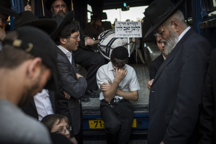 Thousands Mourn Rabbis Slain in Jerusalem Attack
