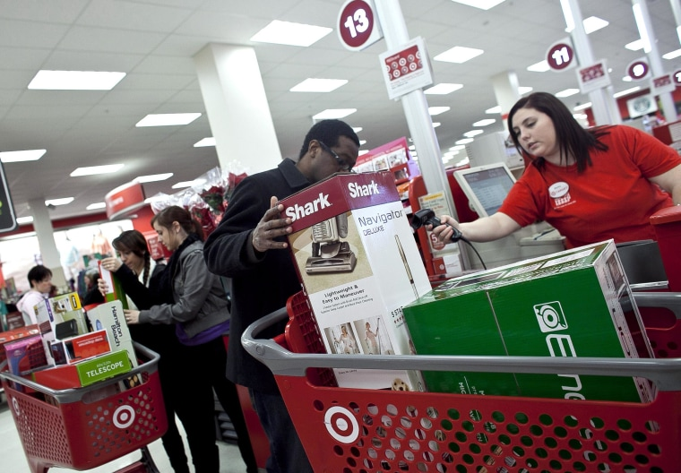 Shoppers check out during Black Friday sales at a Target store in Braintree, Massachusetts, on Nov. 23, 2012.
