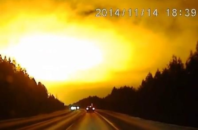 Still from a dashcam video showing the sky lighting up over the Sverdlovsk area of Russia.