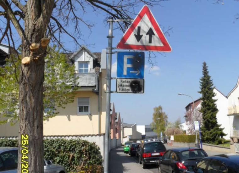 Image: Spray paint covers neo-Nazi graffiti on street signs in Limburg, Germany