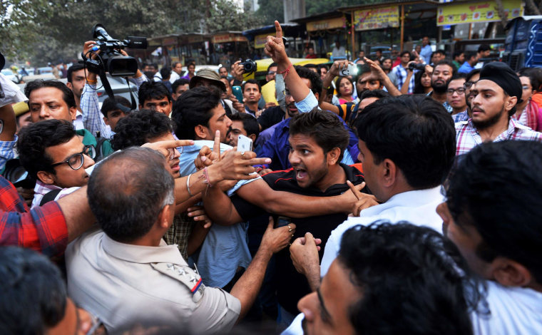 Image: Clashes break out at a rally for the 'Kiss of Love' campaign