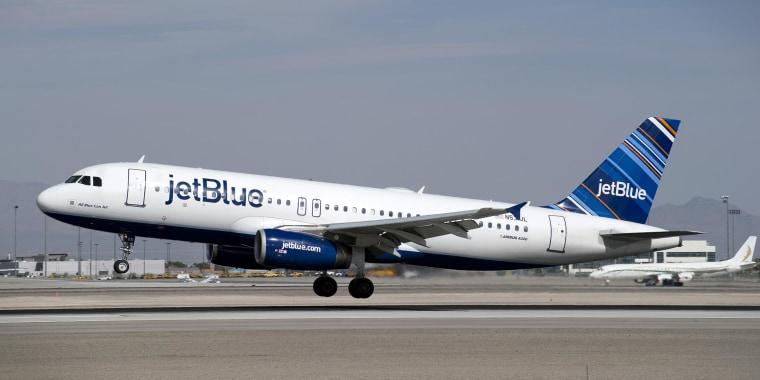 A JetBlue Airways flight lands at McCarran International Airport in Las Vegas, Nevada on Feb. 26.
