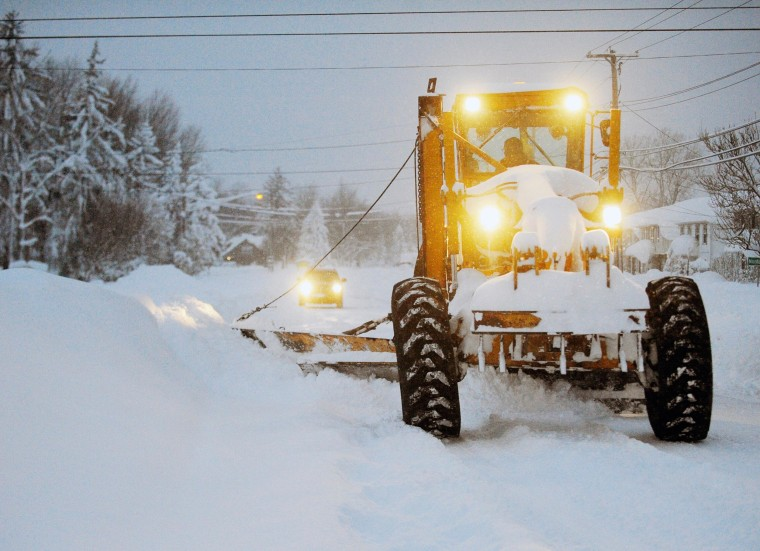 Image: A New York State Snowgrader moves snow on Broadway in Lancaster, N.Y., on Nov. 19.