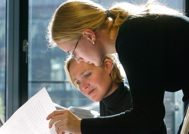 Corporate female employees at work in Germany.