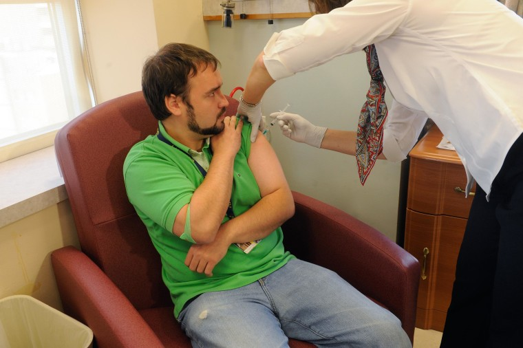 A volunteer gets vaccinated with an experimental Ebola vaccine at the University of Maryland.