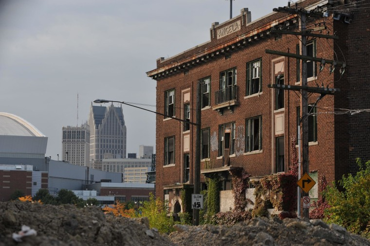 Image: Ford Field, home of the Detroit Lions, is seen near an abandoned building in September 2013.