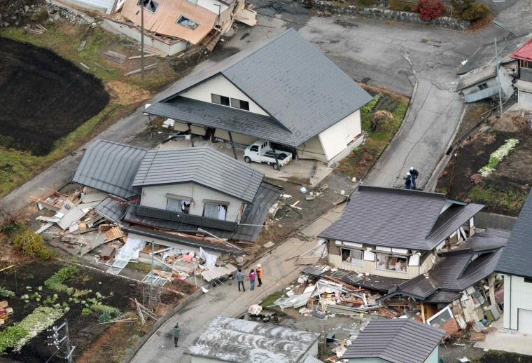 Image: An aerial view shows collapsed houses after an earthquake in Hakuba town, Nagano prefecture