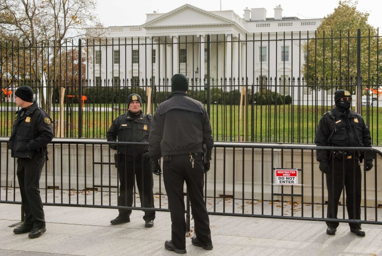 Image: Members of the Uniformed Division of the US Secret Service stand in front White House
