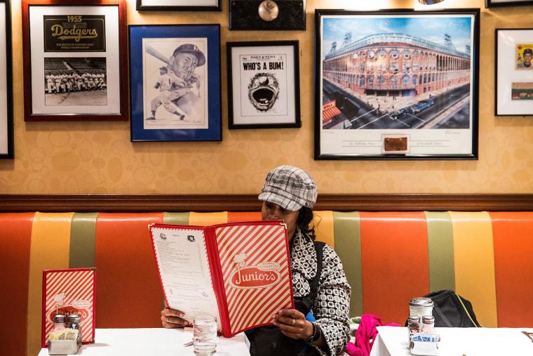 A customer views a menu