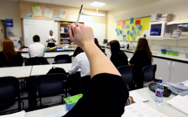 High School Student Raises Hand