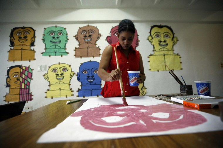 Misleidys Castillo, 29, paints at home. She has autism and is deaf. Misleidy has shown her work in París, next month in Miami and next year she will exhibit in New York