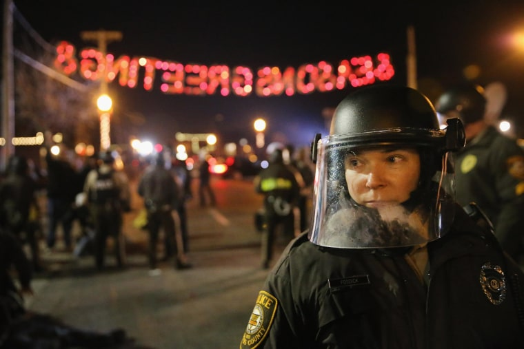 Image: Police confront demonstrators during a protest on November 25, 2014 in Ferguson, Missouri.